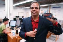 Dr. Ram Dantu showing the mobile phone application that measures blood pressure