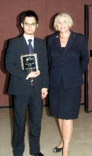 Santi Phithakkitnukoon with UNT President, Dr. Gretchen Bataille, after receiving his award.